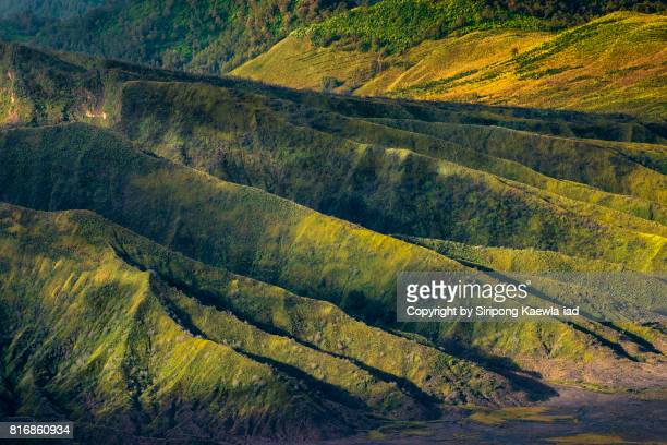 Close up of light and shadow on the mountain ridge line of Batok volcano, East Java, Indonesia.