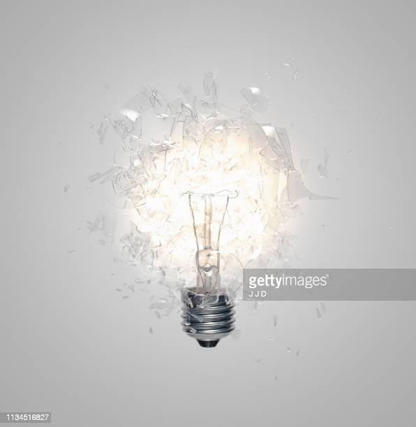 close up of light bulb shattering - gloeilamp stockfoto's en -beelden