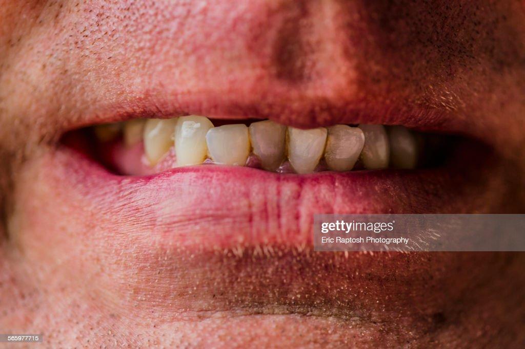 Close up of lips of Caucasian man grimacing : Stock Photo
