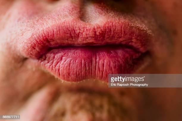 Close up of lips of pouting Caucasian man