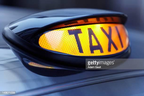 Close up of lit taxi sign