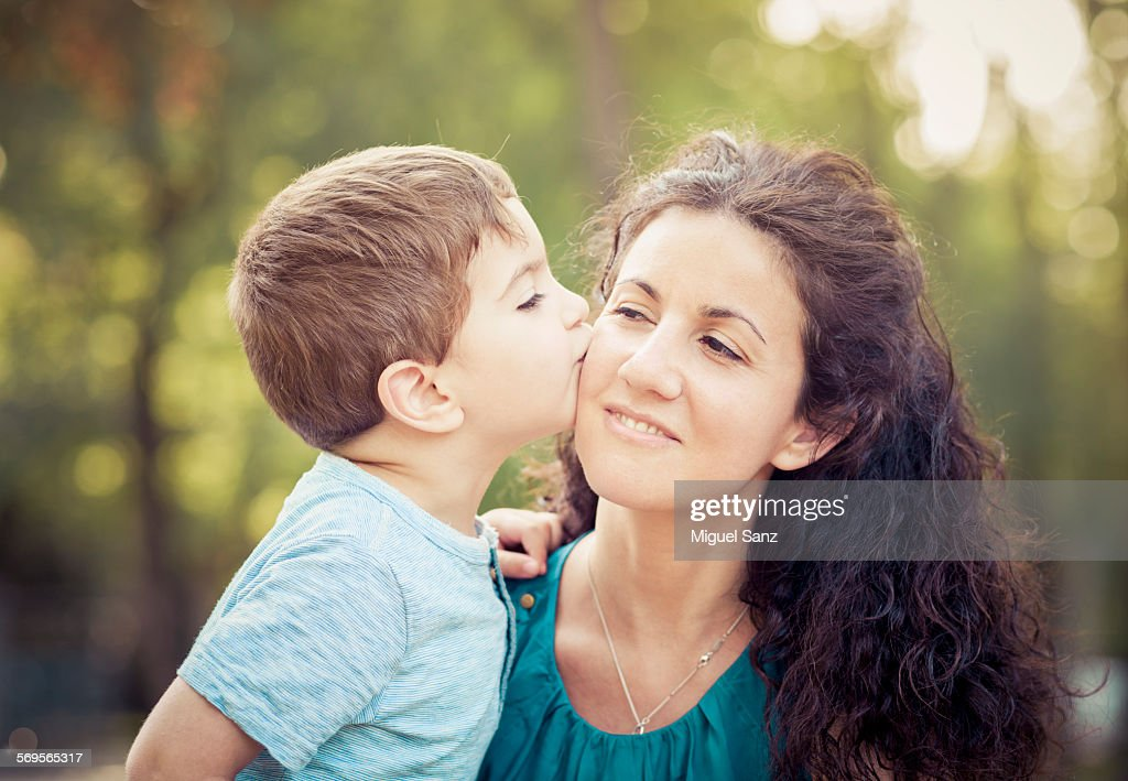 Close up of little boy kissing mother stock photo getty images close up of little boy 3 years kissing mother stock photo thecheapjerseys Gallery