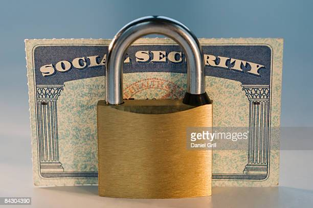 close up of lock and social security card - social security stock pictures, royalty-free photos & images