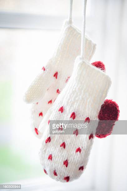 close up of love mittens hanging by the window - mitten stock pictures, royalty-free photos & images