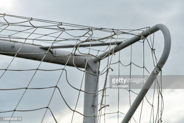 close up of low angle view of soccer goal top corner against a sunny sky - international team soccer stock pictures, royalty-free photos & images