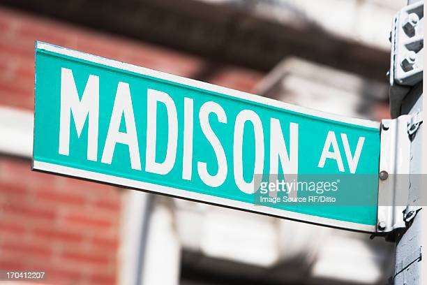 close up of madison avenue sign - madison avenue stock pictures, royalty-free photos & images