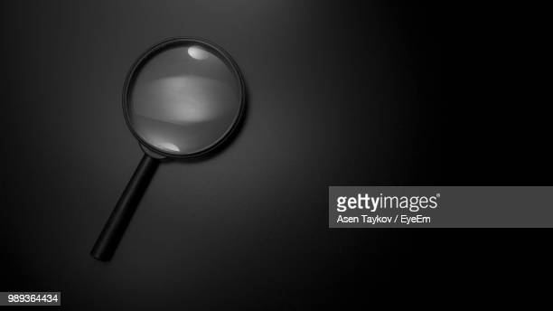 close up of magnifying glass - magnifying glass stock pictures, royalty-free photos & images