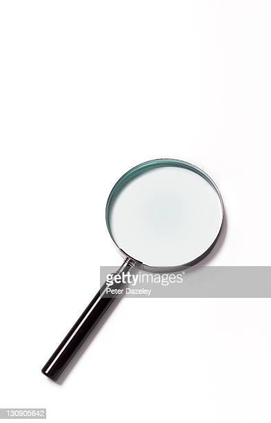 Close up of magnifying glass with copy space