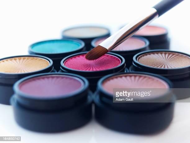Close up of makeup brush and eyeshadows