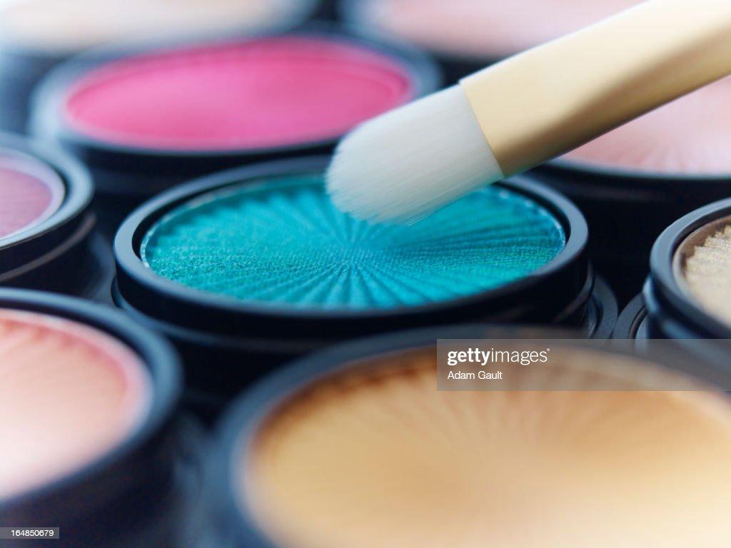 Close up of makeup brush with eyeshadows : Stock Photo