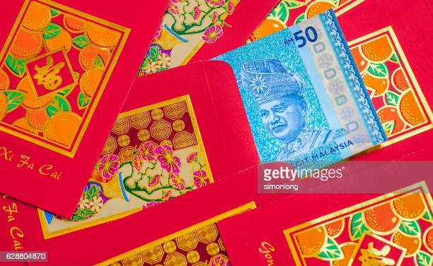 Close up of Malaysian currency with red envelope