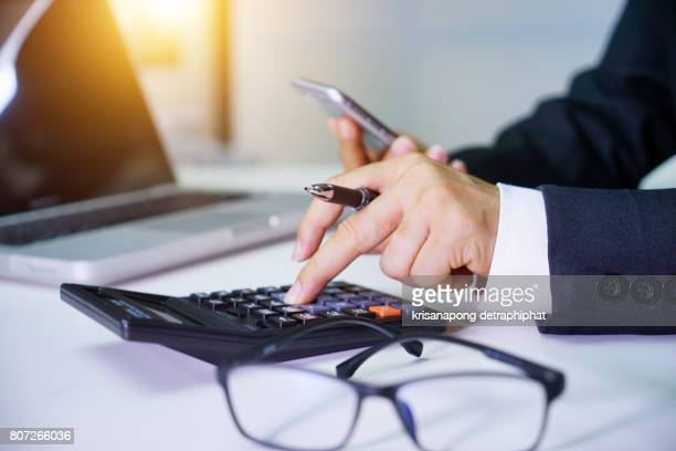 close up of male accountant or banker making calculations. savings, finances and economy concept - calculator stock photos and pictures