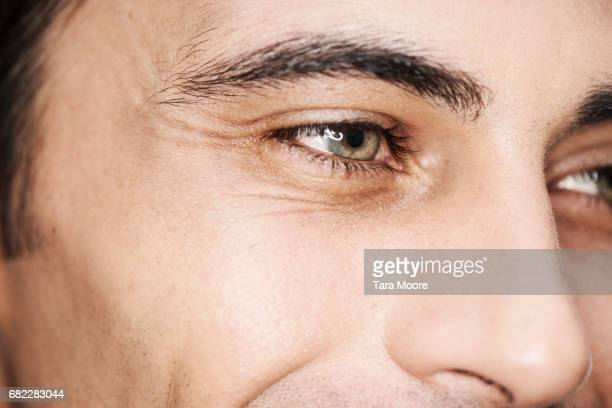 close up of male eyes - green eyes stock pictures, royalty-free photos & images