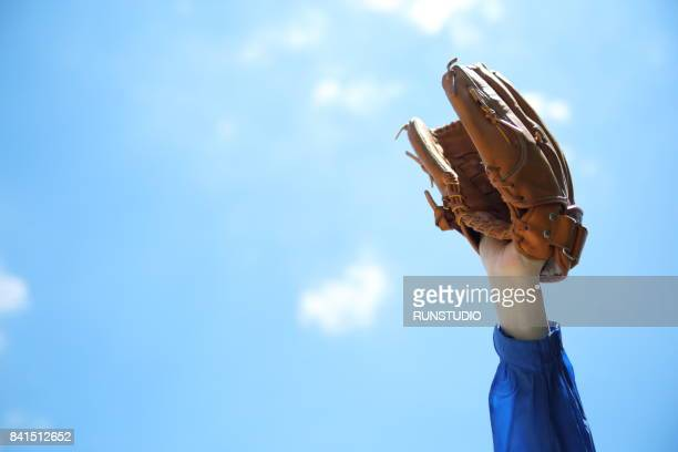 close up of male hand wearing baseball glove - baseball glove stock pictures, royalty-free photos & images