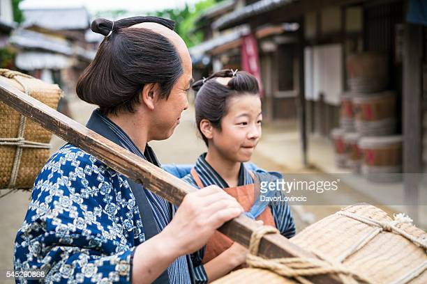Close up of Man and boy while on street, Japan