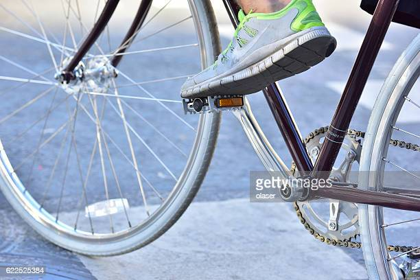 Close up of man and his bike, focus Nike shoe.