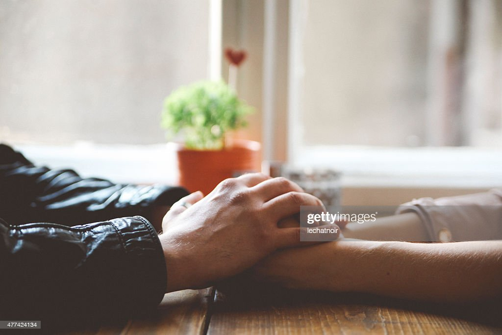 Close up of man and woman's hands : Stock Photo