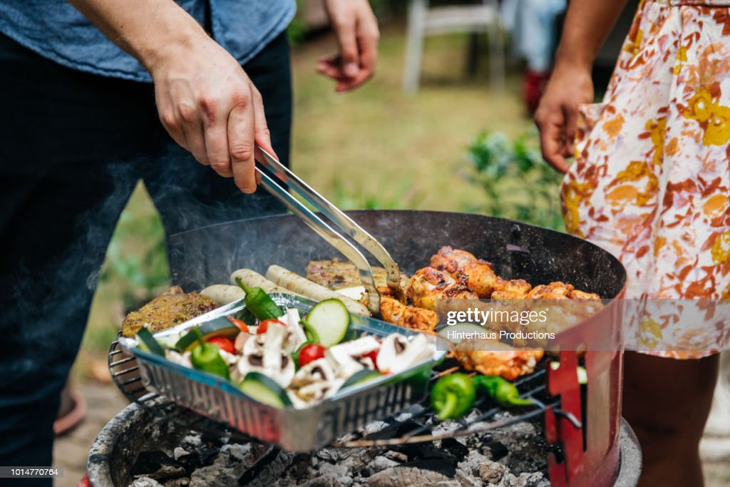 Close Up Of man Cooking Food On BBQ : Stock Photo