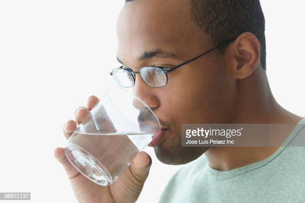 Close up of man drinking glass of water