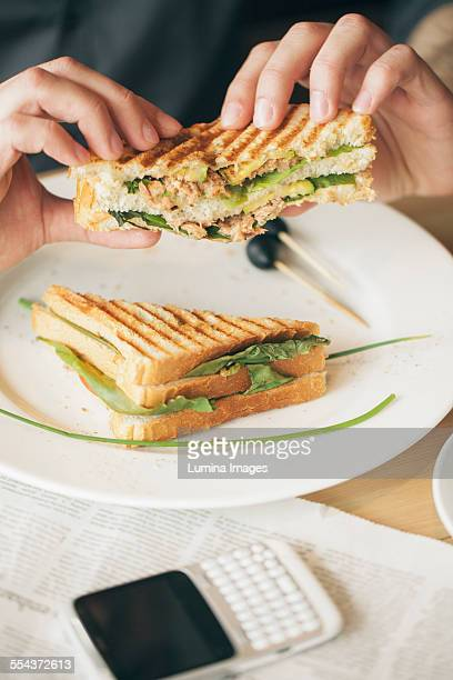 Close up of man eating sandwich