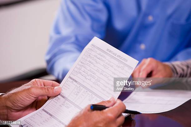 Close up of man filling out form
