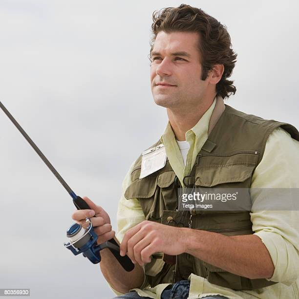 Close up of man fishing