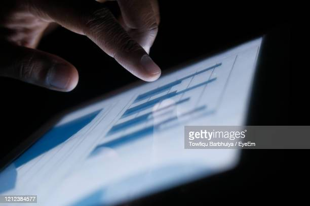 close up of man hand analyzing chart on digital tablet - touch sensitive stock pictures, royalty-free photos & images