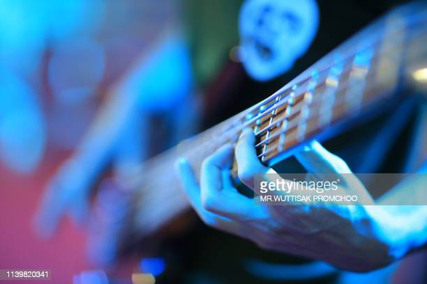 close up of man hand playing guitar. - blues music stock pictures, royalty-free photos & images