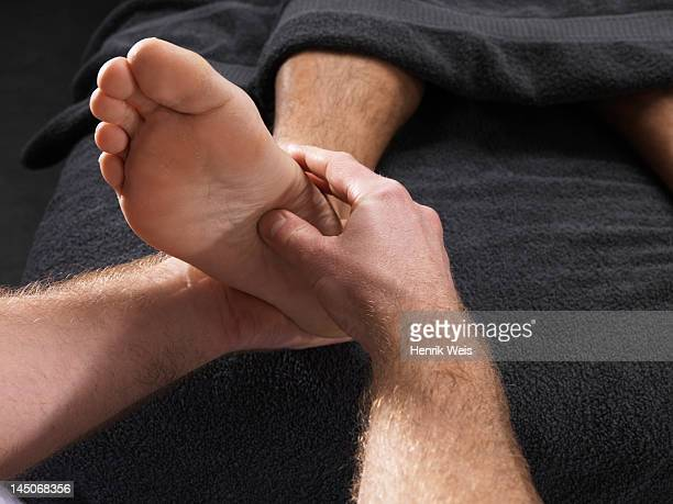 Close up of man having foot massage