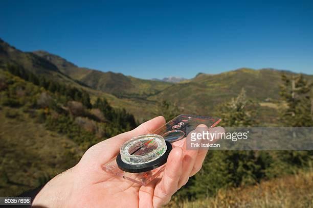 Close up of man holding compass, Utah, United States