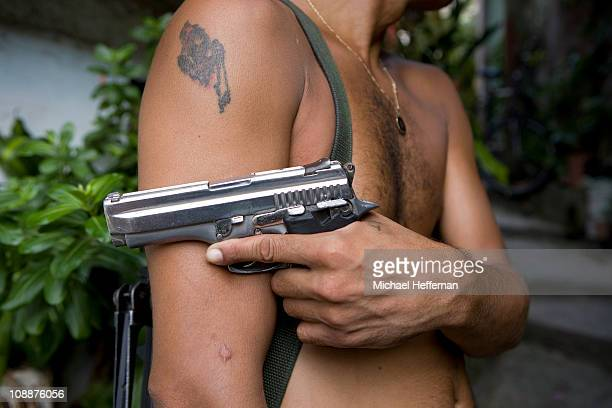 Close up of man holding pistol