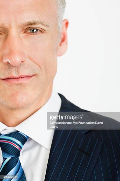 """close up of man in suit - """"compassionate eye"""" fotografías e imágenes de stock"""