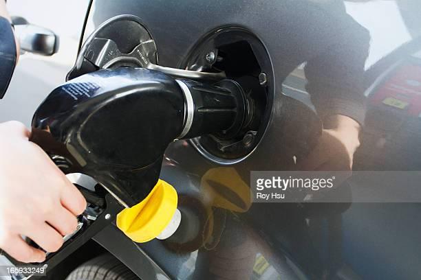Close up of man pumping gas