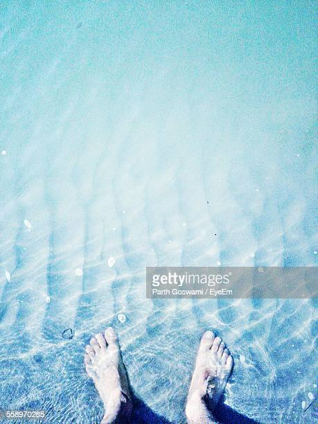 Close Up Of Man Standing In Sea