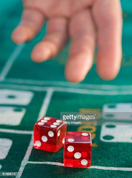 Close up of man throwing dice