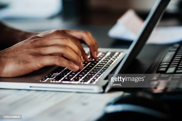 close up of man typing on laptop - person on laptop stock pictures, royalty-free photos & images