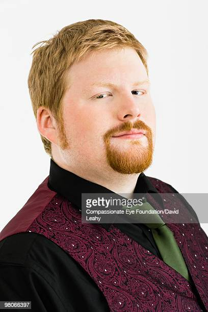 """close up of man wearing a green tie - """"compassionate eye"""" stock pictures, royalty-free photos & images"""