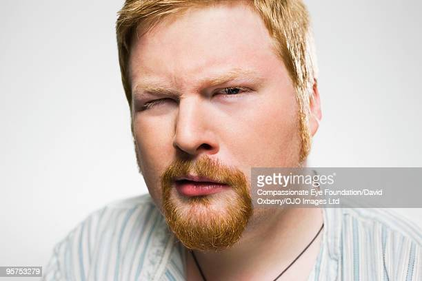 """close up of man winking - """"compassionate eye"""" stock pictures, royalty-free photos & images"""