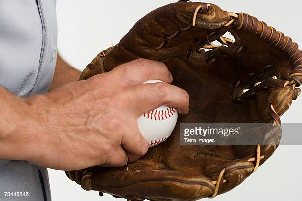 close up of man with baseball glove and baseball - baseball glove stock pictures, royalty-free photos & images