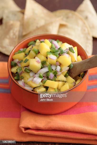 Close up of mango salsa and tortilla chips