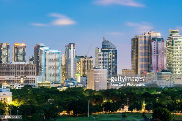 close up of manila night skylines - manila philippines stock pictures, royalty-free photos & images
