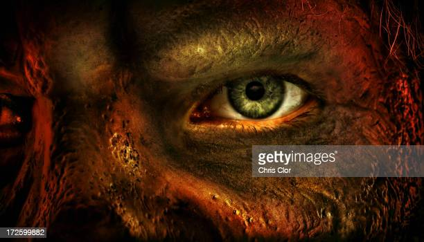 close up of man's eye and burned skin - very scary monsters stock photos and pictures