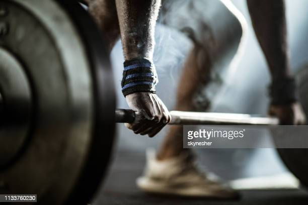 Close up of man's hand during deadlift.
