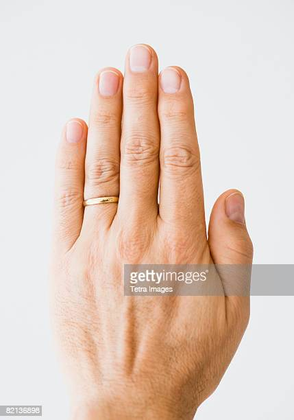 Close up of man?s hand wearing wedding ring