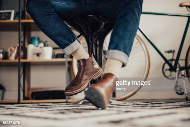 Close up of man's legs under the table