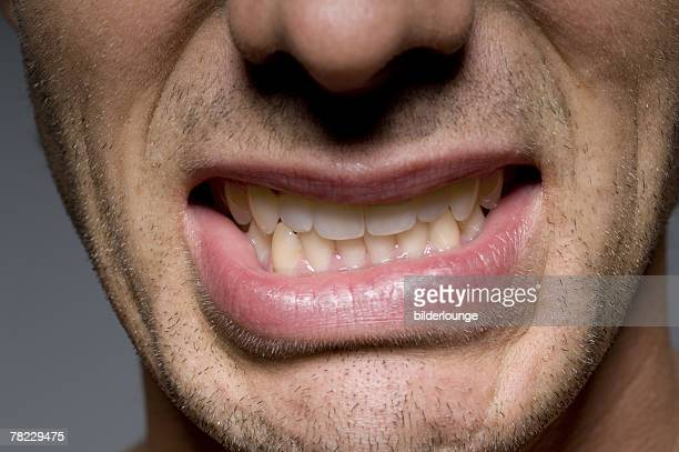 close up of man?s mouth with clenched teeth