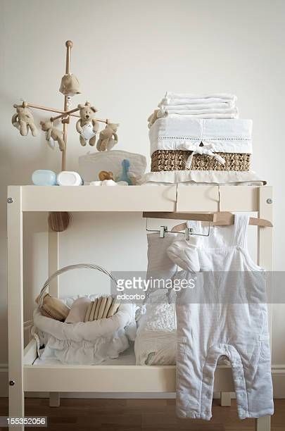 Close up of many newborn nursery items on a table