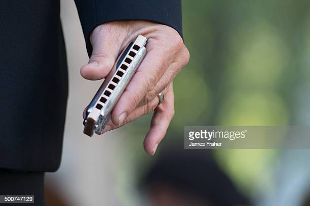 A close up of Mark Hummel's hand holding a harmonica while performing on stage at The Chicago Blues Festival on June 13 2014 in Chicago Illinois...