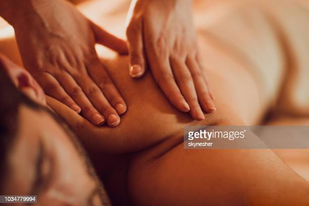 close up of massaging man's back at the spa. - massaggi foto e immagini stock