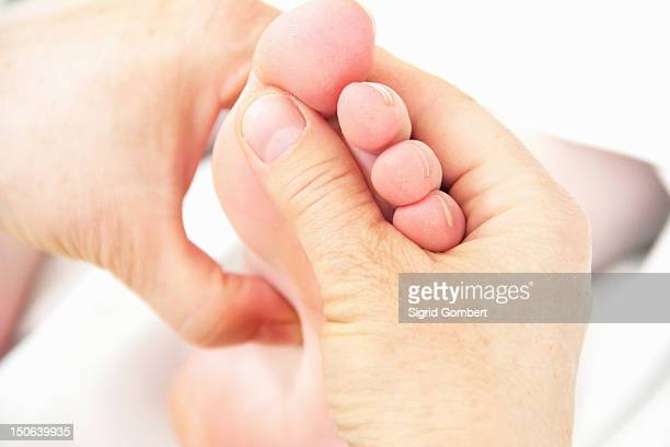 Close up of masseuse working on feet